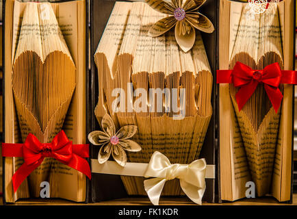 Book Folding. Art created by folding the pages of a hardback book to form images or words. They can be decorated - Stock Photo