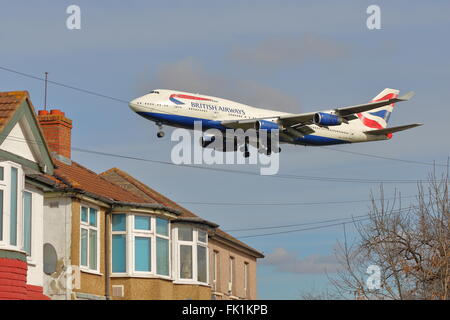Low flying British Airways Boeing 747-400 G-CIVN landing at London Heathrow Airport, UK - Stock Photo