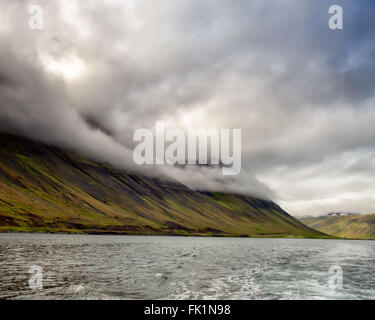 Isafjordur, Westfjords, Iceland. 2nd Aug, 2015. Low-lying clouds cover the towering mountains of the Westfjords - Stock Photo