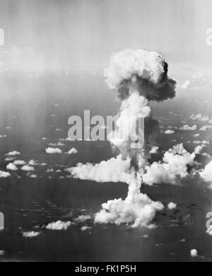 Nuclear Explosion. Ships beneath the mushroom cloud from Operation Crossroads nuclear weapons test at Bikini Atoll, - Stock Photo