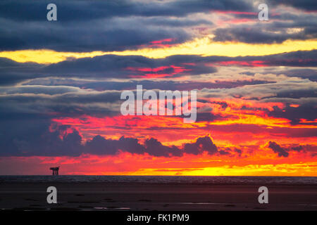 Southport, Merseyside, UK 5th March, 2016.   UK Weather.  Morecambe Bay Gas Rig silhouetted by a glorious sunset - Stock Photo