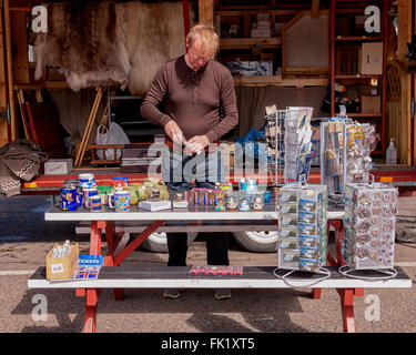 Isafjordur, Westfjords, Iceland. 2nd Aug, 2015. Local Icelander selling tourist souvenirs on the dock in Sundahofn - Stock Photo
