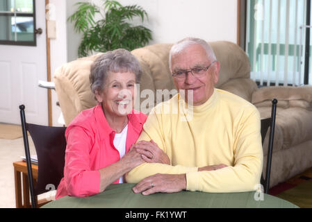 Casual portrait of a happy couple in their mid-eighties. - Stock Photo