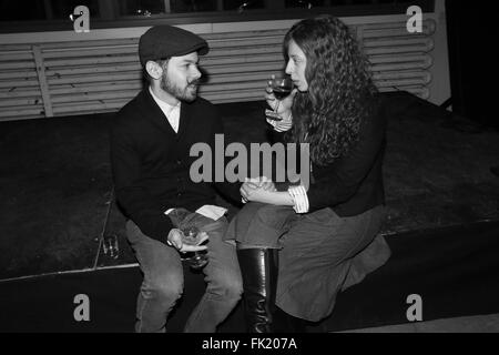 Brooklyn, NY, USA. 25th Feb, 2016. William Reder drinks with Kaitlyn O'Conner at the Knock Three Times: Pre-Release - Stock Photo