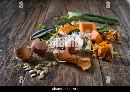 Organic leftovers, waste from vegetable ready for recycling and to compost. Collecting food leftovers for composting. - Stock Photo