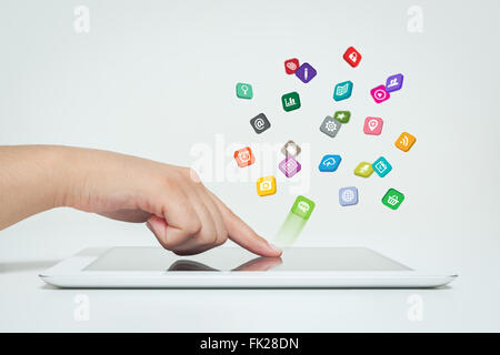 application icons fly off the tablet computer in hand - Stock Photo