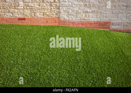 Artificial grass / astro turf on a new build housing estate. Bicester, Oxfordshire, England - Stock Photo