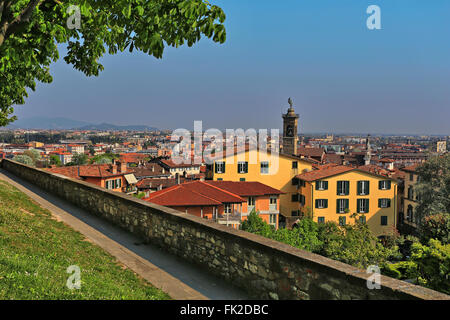 View over Bergamo Bassa from the path along the walls around Bergamo Alta, Lombardy, Italy - Stock Photo