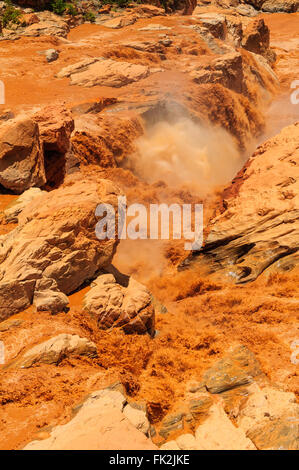 Betsiboka River rapids in rain season with red sediments, Madagascar - Stock Photo