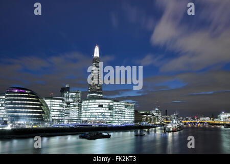 View of the South Bank of the Thames in Southwark at night showing City Hall and the Shard - Stock Photo