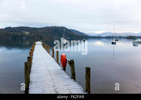 Sailboats and a pier on Lake WIndemere in early morning - Cumbria, England - Stock Photo