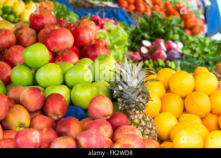 Apples, oranges and other fruits for sale at a market in Istanbul - Stock Photo