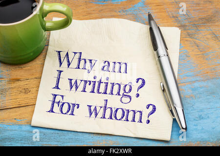 Why am I writing? For whom? - Writer or author questions on a napkin with a cup of coffee - Stock Photo