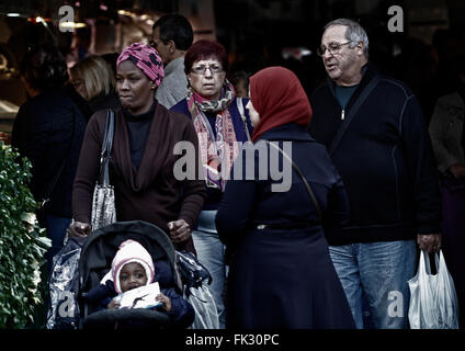People from different cultures walking through a traditional market Mallorca. - Stock Photo