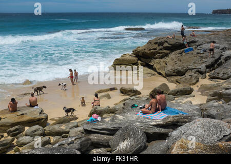 people in a cove along the Coogee to Bondi coastal walk, Sydney, NSW, Australia - Stock Photo