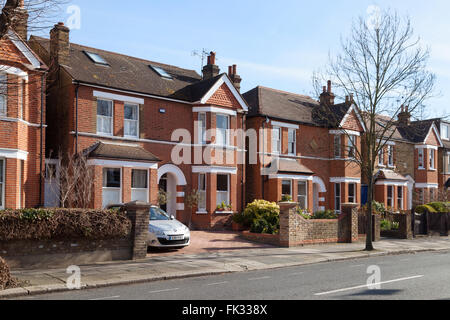 Detached houses on a street in Ealing, West London, UK - Stock Photo