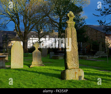 Anglo Saxon cross in the churchyard of Whalley parish church, Lancashire, England UK - Stock Photo