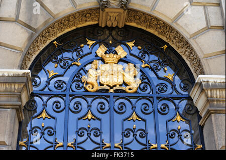 Symbolic Coat of Arms above the doorway of one of the entrances to the historic Old Royal Naval College, London, - Stock Photo