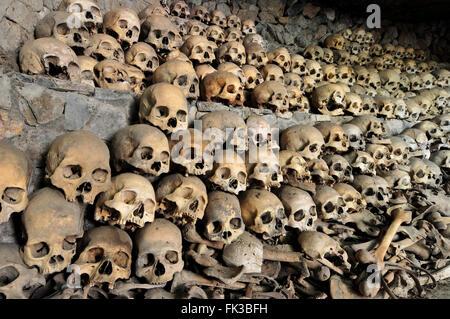 Skulls and bones in Opdas Mass Burial Cave, Benguet, Philippines - Stock Photo