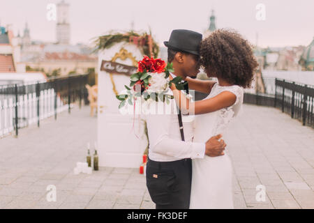 happy black wedding couple softly hugging on the rooftop during the fk3def Email Order Partner Cost   How Much Are you able to Expect to Spend?