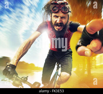 Funny image of a shouting bicyclist - Stock Photo