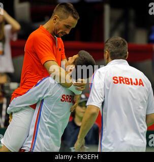 Belgrade. 6th Mar, 2016. Serbia's tennis players Viktor Troicki (L) and Novak Djokovic (C) celebrate victory against - Stock Photo