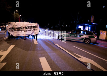 Munich, Germany. 06th Mar, 2016. After an arson against a future refugee housing unit in Munich, anti-facist activists - Stock Photo