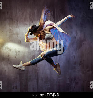 Fit young hip hop dancer during the performance - Stock Photo