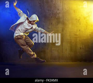 Athletic b-boy dancing a hip hop - Stock Photo