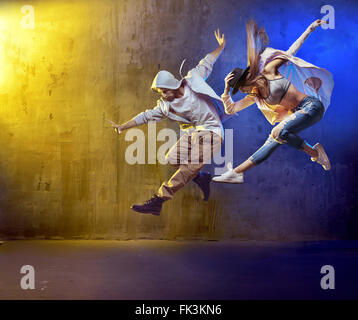 Stylish dancers dancing in a concrete place - Stock Photo