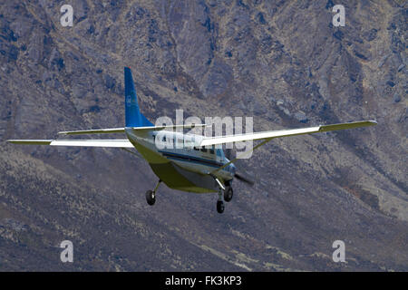 Air Milford tourist plane (Cessna 208) landing at Queenstown Airport, Otago, South Island, New Zealand - Stock Photo
