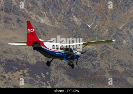 Milford Sound Flights Gippsland GA8 plane landing at Queenstown Airport, Otago, South Island, New Zealand - Stock Photo