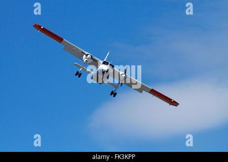 Light tourist plane landing at Queenstown Airport, Otago, South Island, New Zealand - Stock Photo