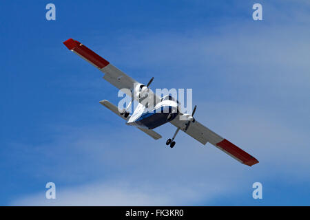 Light tourist plane landing at Queenstown Airport, Otago, South Island, New Zealand - Stock Photo