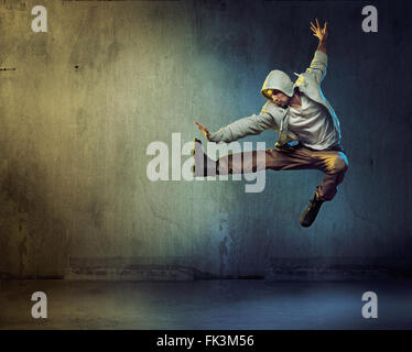 Athletic dancer in a super jumping pose - Stock Photo