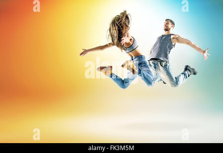 Two talented dancers practicing in large studio - Stock Photo