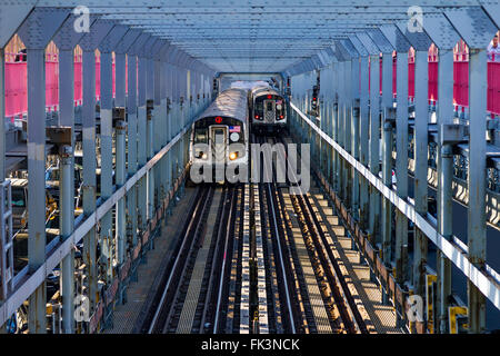 Subway cars crossing the Williamsburg Bridge between Brooklyn and Manhattan in New York City - Stock Photo