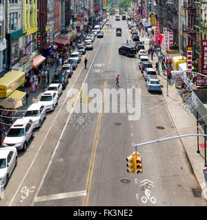 NEW YORK CITY - JULY 2015: People shop at stores along a busy block in the Chinatown neighborhood of Manhattan during - Stock Photo