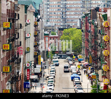NEW YORK CITY - JULY 2015: Cars and signs line a busy street in Chinatown during the Fourth of July holiday in Manhattan, - Stock Photo