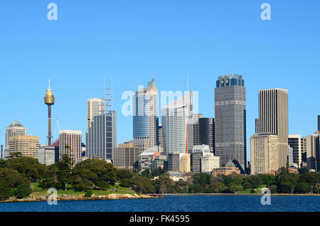 View from water on the sydney cbd with sydney tower and skyscrapers and royal botanic garden with tourists - Stock Photo