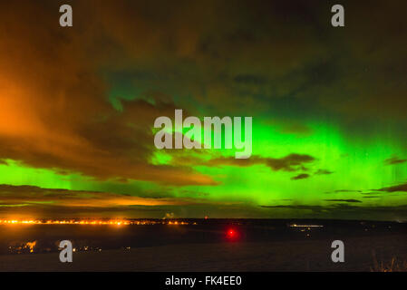 The Aurora Borealis (Northern Lights) light up the sky above Inverness in the Highlands of Scotland. The Aurora - Stock Photo