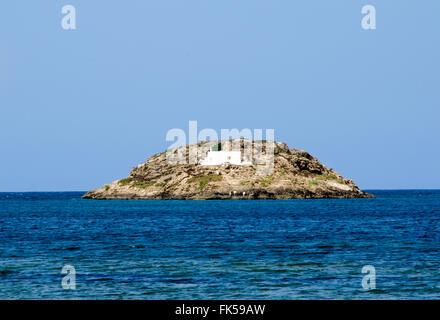 Deserted small island with a white small chapel.Aegean sea,Sporades islands,Skyros,Greece - Stock Photo
