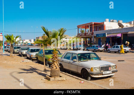 Grand taxis on Avenue Hassan II, main street, Tan Tan Plage, southern Morocco, northern Africa - Stock Photo