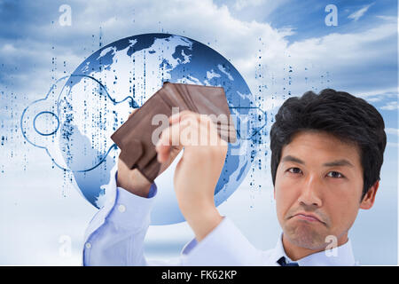 Composite image of businessman showing his empty wallet - Stock Photo