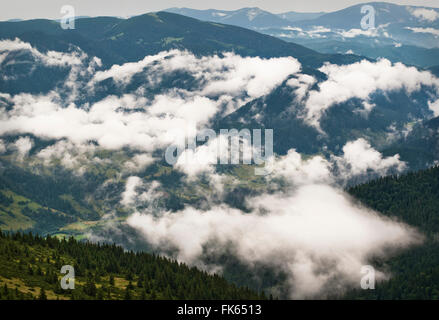 Formation of clouds in the mountains after the rain. Carpathians. Ukraine - Stock Photo