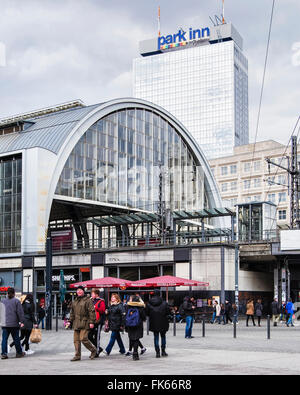 Berlin Alexanderplatz S-bahn railway station exterior and Park Inn - Stock Photo
