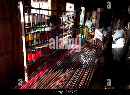 Woman arranging silk threads by colour at Ko Than Hlaing Weaving workshop, Inpawkhon, on Inle Lake, Shan state, - Stock Photo