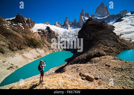 Hiker taking a photo of Mount Fitz Roy (Cerro Chalten), El Chalten, Patagonia, Argentina, South America - Stock Photo