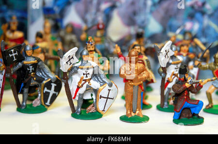 Colorful medieval toy soldiers in a row - Stock Photo