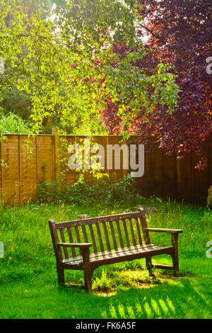 A bench in a park. London, United Kingdom. - Stock Photo